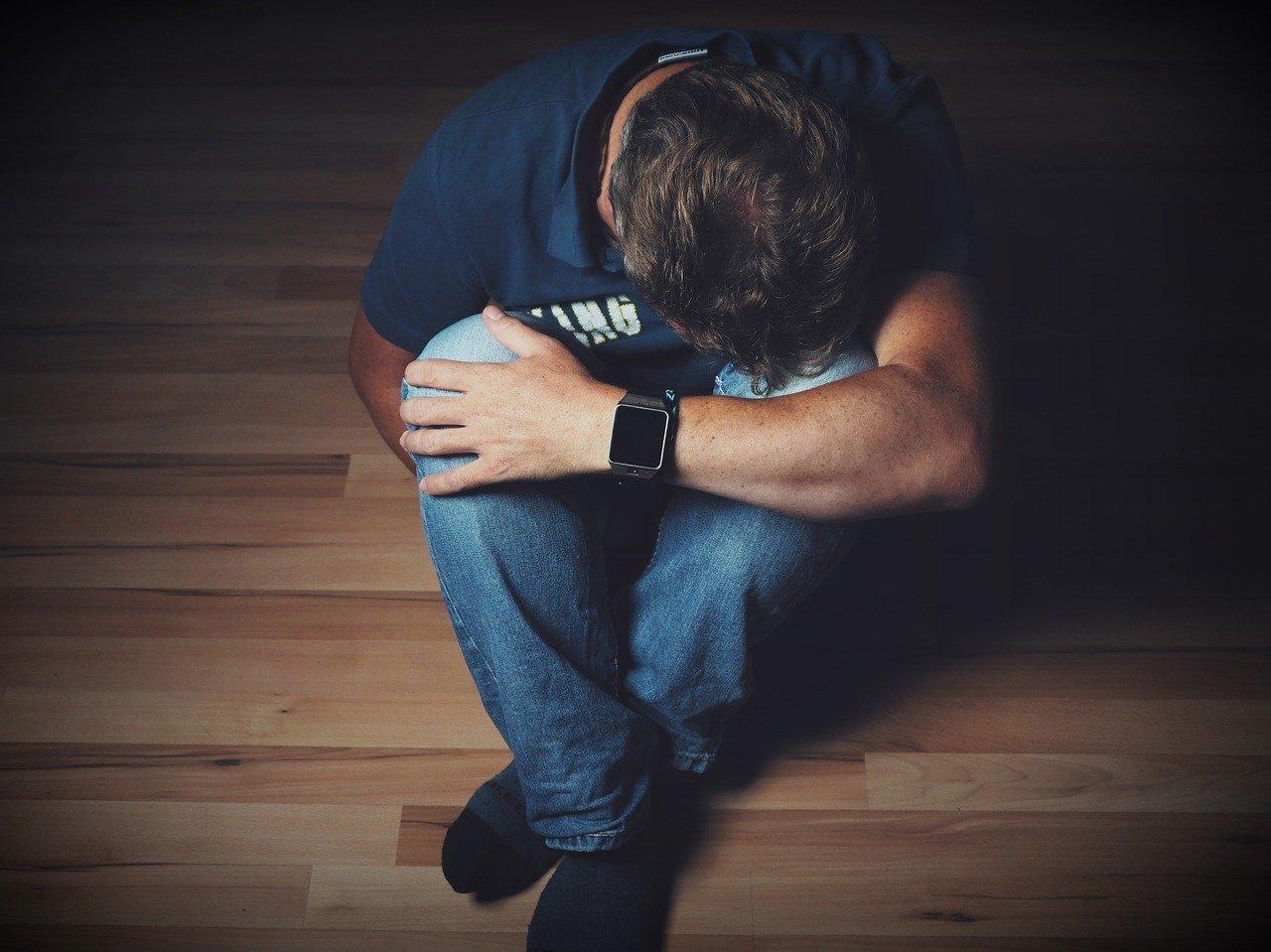 man, depressed, sitting